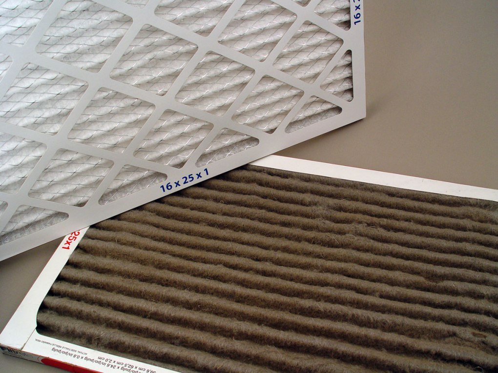Dirty home air filter compared to a clean air filter