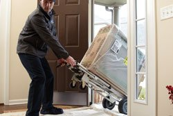 Extreme Comfort Air Conditioning & Heating technician delivering and installing new ac system in home