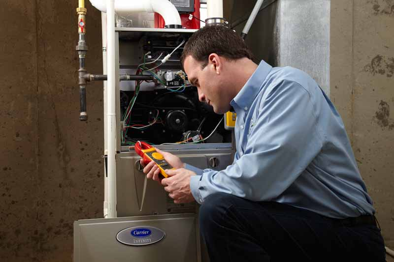 Man diagnosing broken air conditioning furnace with 10 troubleshooting tips